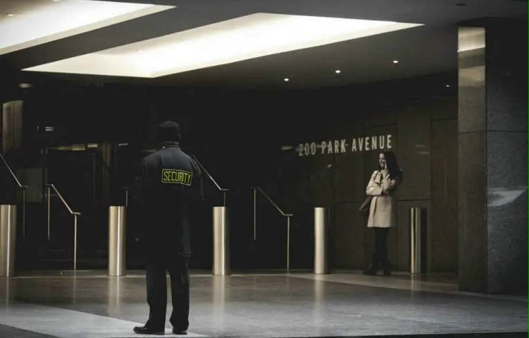 Unarmed security guard outside an ohio high rise building