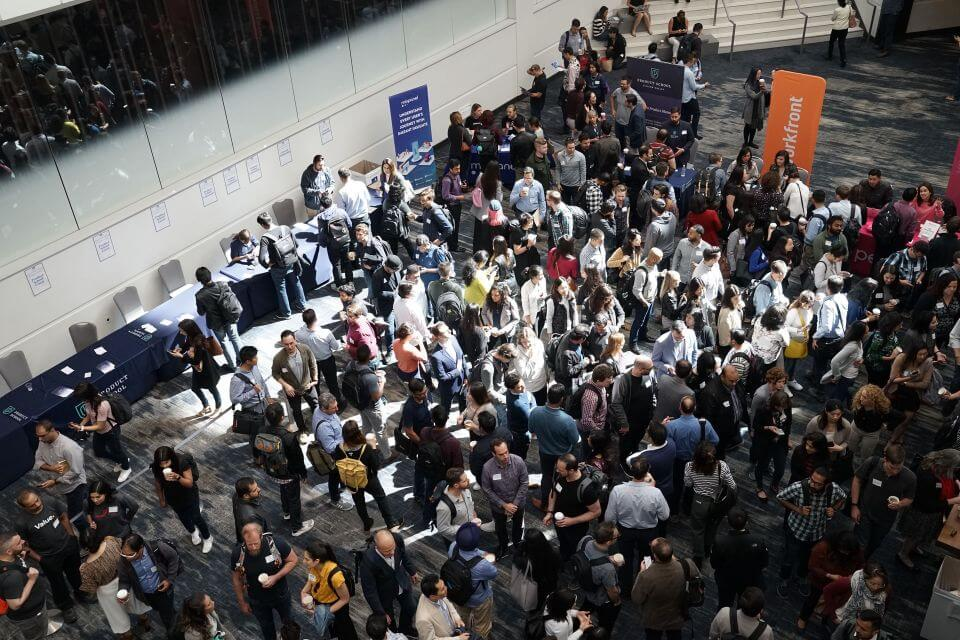 Thousands of people waiting in the entrance lobby to enter a convention/tradeshow