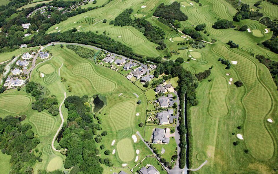 aerial view of a a golf course with houses