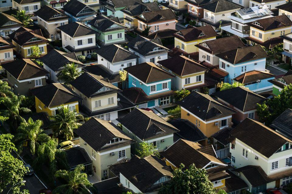 Aerial view of several rows of houses in a HOA governed neighborhood